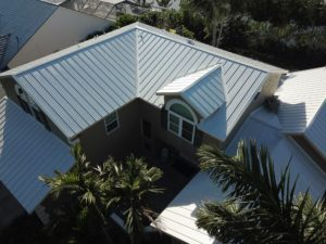 The sprawling metal roof of a large residential building.