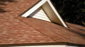 Red and orange asphalt shingles that have been meticulously installed.