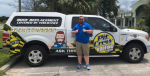 Pit Crew team member with our branded truck